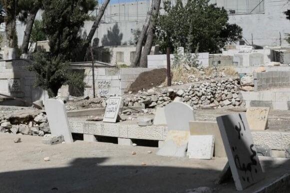 Muslim cemetery damaged by Israeli wall