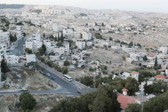 Har Homa, illegal Jewish settlement, photographed from Bethlehem by Teju Cole