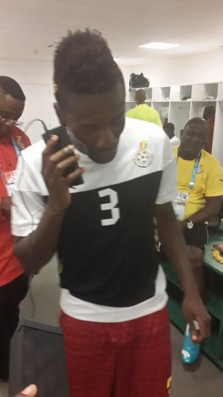 Ghana's Asamoa Gyan takes a call from his country's president before yesterday's match with Germany, in which he scored