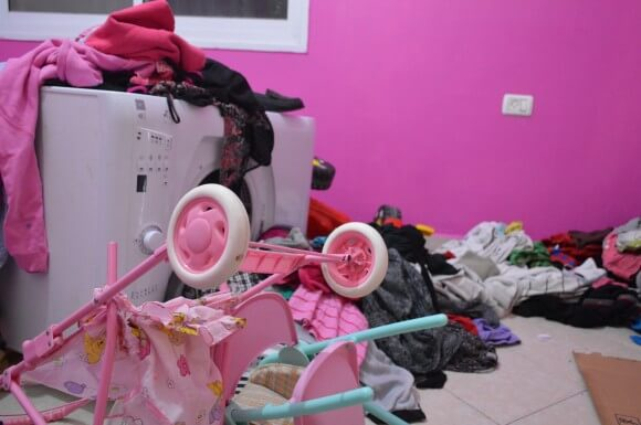 Ashraf Najar's daughter's room after the night raid. The laundry machine, which usually sits in the closet of the room was pulled out of the wall and thrown into the girl's room. (Photo: Sheren Khalel)