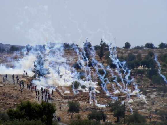 Teargas canisters raining down on Bil'in demonstrators. (Photo: Hamde Abu Rahmah)