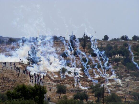 Teargas canisters raining down on Bil'in demonstrators. (Photo: Hamde Abu Rahmah)