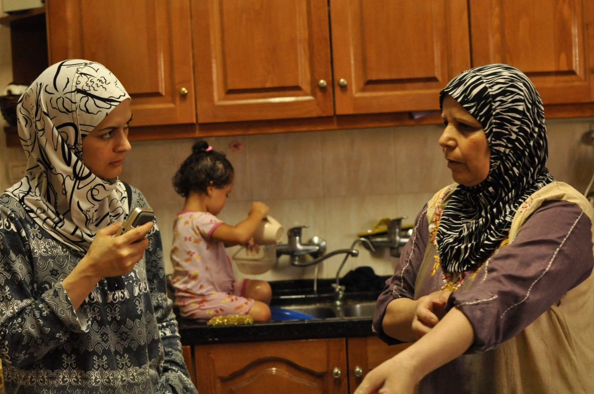 Gaza Kitchen author Laila El-Haddad (left) with Um Ramadan, a Palestinian living in Gaza City whose family is originally from Yaffa. In the background is Laila's daughter Noor. (Photo: Maggie Schmitt)