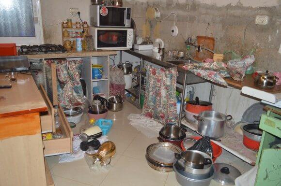 Mustafa Najar's kitchen after a night raid. (Photo: Sheren Khalel)