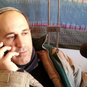 Arieh King being interviewed on a radio show in Jerusalem. (Photo: YishaiFleisher.com)