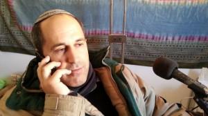 Arieh King being interviewed on a radio show in Jerusalem. (Photo: YishaiFleisher.com)