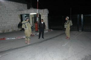 Israeli soliders talk with Bir Zeit University security after taking control of campus entrances. (Photo: Allison Deger)