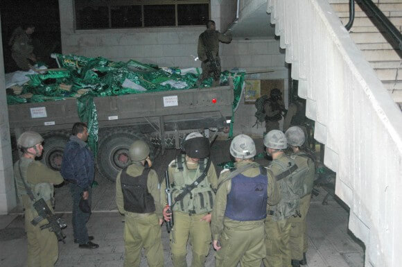 Israeli soldiers raiding Bir Zeit University in the West Bank in the first night incursion since the establishment of the Palestinian Authority, 19 June 2014. (Photo: Allison Deger)