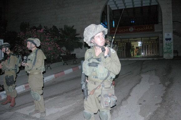 Israeli soldiers in front of the Bir Zeit University student union. 19 June 2014. (Photo: Allison Deger)