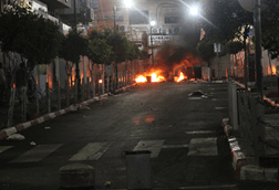 Clashes between the Israeli army and Palestinian protesters in downtown Ramallah. (Photo: Mohammed Othman)