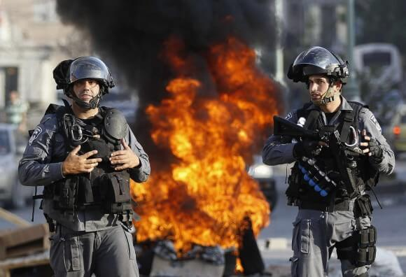 Israeli police officers stand guard during a protest by Palestinian citizens of Israel in the city of Nazareth against Israel's offensive in the Gaza Strip July 21, 2014. (Photo: REUTERS/Ammar Awad)