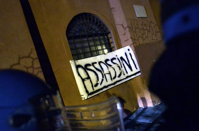 "Pro-Israel protesters attached a banner reading ""Assassins"" to the wall of the Palestinian embassy in Rome (Photo: Caprioli/Toiati)"