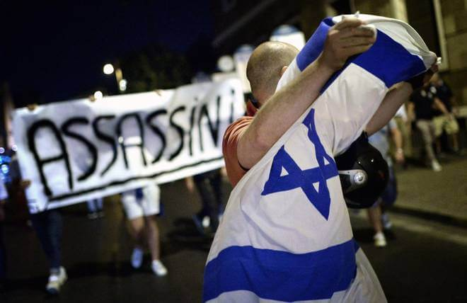 "Israel supporters march from Jewish ghetto to the Palestinian embassy in Rome with ""Assassins"" banner after teens were kidnapped (Photo: Caprioli/Toiati)"