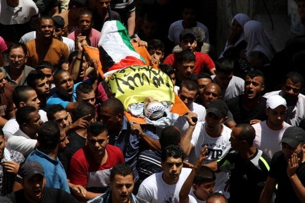 Palestinians attend the funeral ceremony of Youssef Abu Zagha in Jenin, West Bank on July 1, 2014.  (Photo: Nedal Eshtayah/Anadolu Agency/Getty Images)