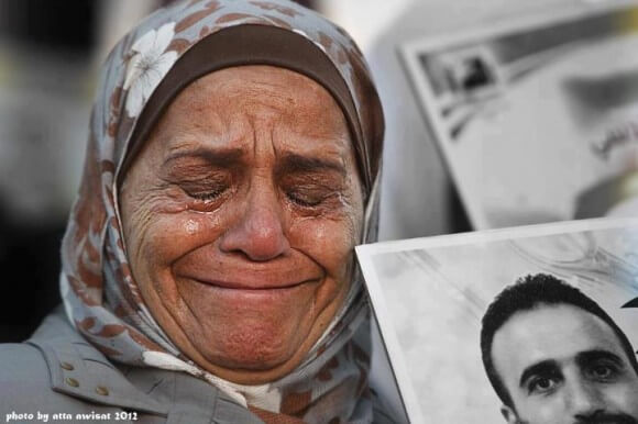 A Gaza parent. Photo from 2012 by Atta