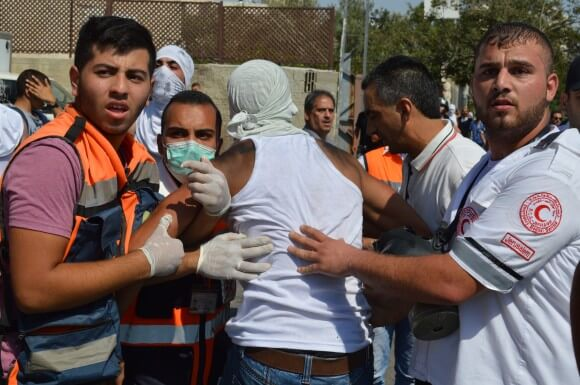 Injured young man carried away by medics at clashes in Shufat after funeral. (Photo: Matthew Vickery)