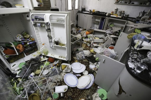 """A kitchen in the Qawasmeh family home.  """"They didn't leave one glass unbroken,"""" says Umm Sharif Qawasmeh. (Photo: Kelly Lynn)"""