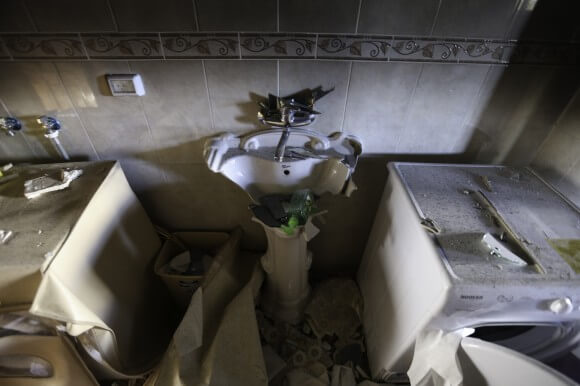 Several families live together in the large home.  Every sink was broken by Israeli soldiers. (Photo: Kelly Lynn)