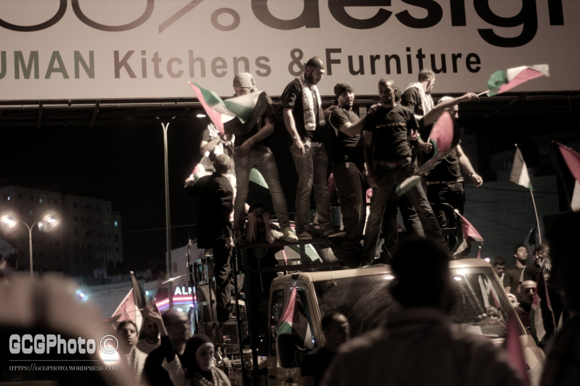 Demonstrators on a truck on its way from downtown Ramallah to Qalandyya. (Photo: Guglielmo Grandinetti)