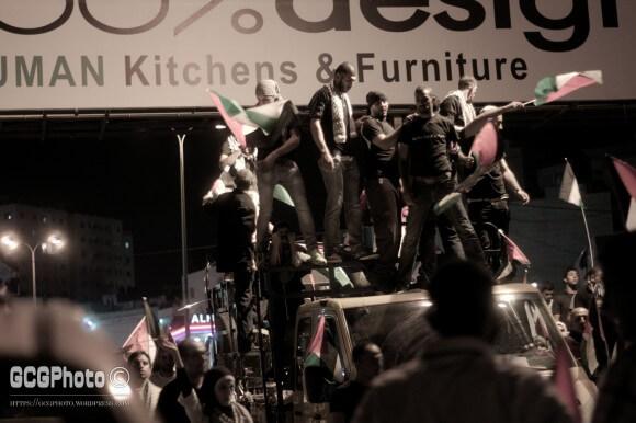 Demonstrators on a truck on its way from downtown Ramallah to Qalandyya. (Photo: Guglielmo Grandinetti)