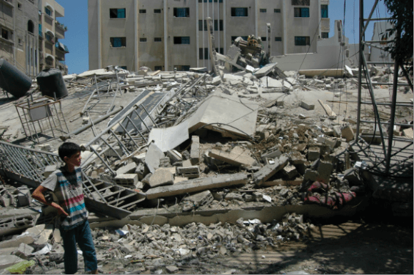 Palestinian child views his destroyed home for the first time during ceasefire hours in the Shuja'iyeh neighborhood of northern Gaza. (Photo: Allison Deger)
