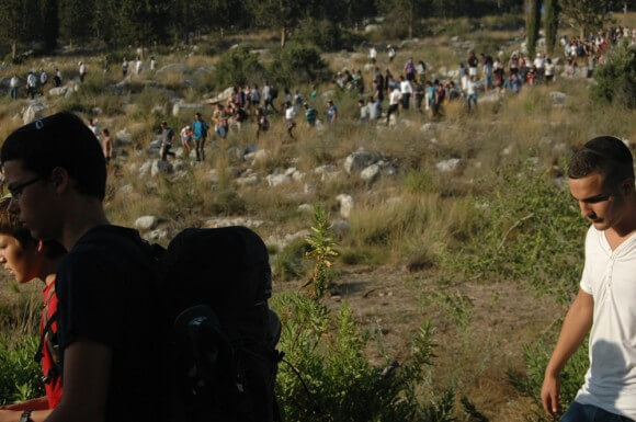 Mourners walk to the joint funeral for the three abducted Israeli youth in Modiin, near Jerusalem. (Photo: Allison Deger)