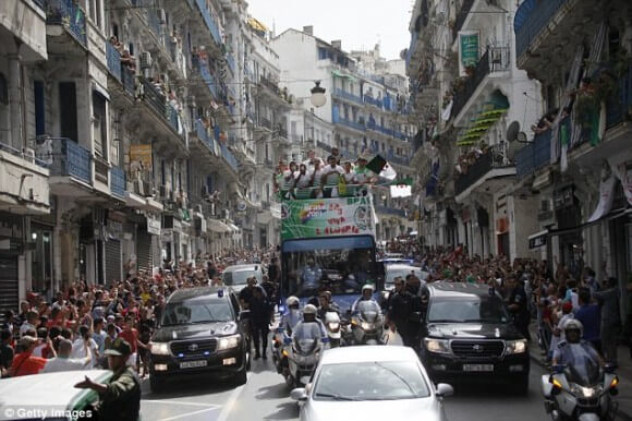 The Algerian national soccer team returns to a hero's welcome after being ousted from the World Cup by Germany. (Photo: Getty Images)