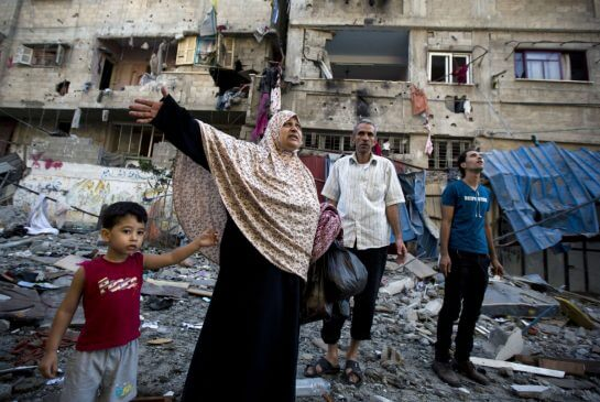 A Palestinian family leaves its house in Gaza City after it was damaged in an Israeli airstrike. (Photo: MOHAMMED ABED / AFP/GETTY IMAGES)
