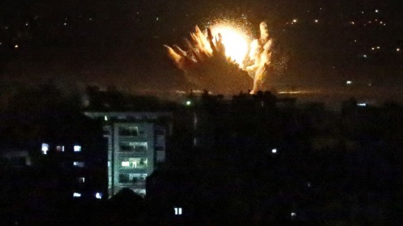 An Israeli missile hits Palestinian buildings in Gaza City on July 17. (Photo: Thomas Coex / Getty Images)