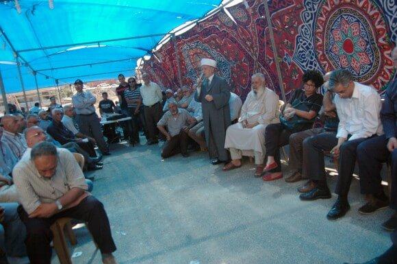 Father of Mohammed Abu Khudier (left) in mourners tent, Shuafat. (Photo: Allison Deger)