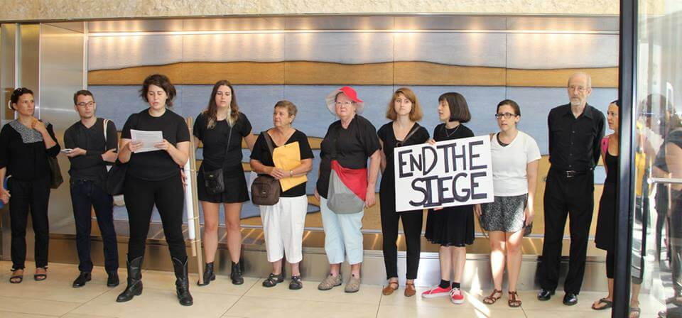 Jewish Voice for Peace members call for an end to the blockade of Gaza inside the UJA-Federation building in New York. (Photo: Jewish Voice for Peace NY/Facebook)