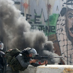 Israeli soldiers keep their position during clashes with Palestinian stone throwers at the Qalandia checkpoint between the West Bank city of Ramallah and Jerusalem on September 21, 2011. (Ahmad Gharabli/AFP/Getty Images)