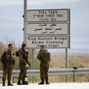 Israeli soldiers stand guard near the entrance to Allenby Bridge. (Photo: REUTERS/Ronen Zvulun )