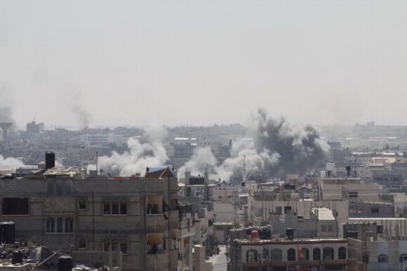 Smoke billows from buildings following an Israeli military strike east of Rafah in the southern Gaza Strip, on August 1, 2014. (Photo: SAID KHATIB/AFP/Getty Images)