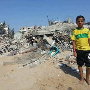 Talal's 11-year son standing on the wreckage of Gehad's house