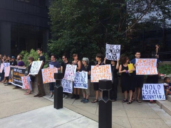 Protesters outside the Jewish Federations office yesterday