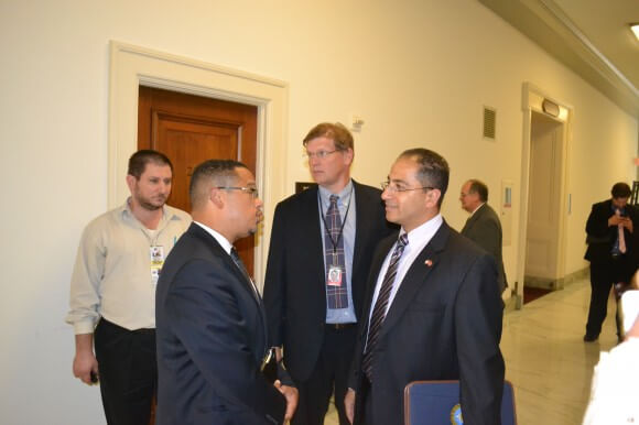 Rep. Keith Ellison, left , outside of the briefing room in Rayburn House Office Building. (Photo: Sam Knight)