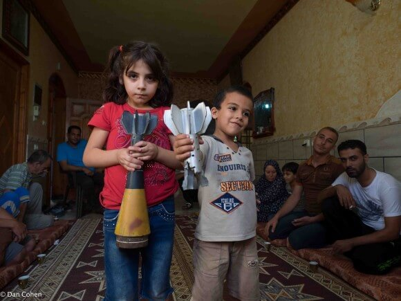 Dima and Kamal Qadan display bombs dropped onto their home by Israeli warplanes. (Photo: Dan Cohen)