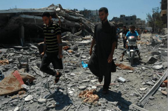 Palestinians flee from the Shuja'iyeh neighborhood in the northern Gaza Strip. (Photo: Allison Deger)