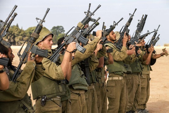 Israeli soldiers check their weapons on the southern border with the Gaza Strip. (Photo: Agence France-Presse/Getty Images)