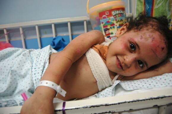 Hana Abu Eidah, 2, injured in an air strike in Jabaliya in northern Gaza. (Photo: Allison Deger)