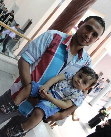 Mohammed abu Louz with his child Malak.