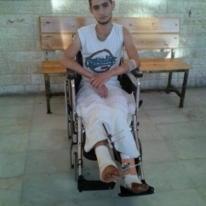 Ahmed Abu Shanab sitting in Al-Quds hospital.
