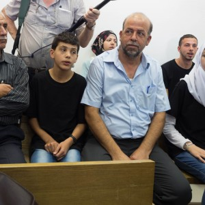 The Abu Khdeir family sits in the courtroom with shirts that bear Mohammed's image inside-out. (Photo: Dan Cohen)