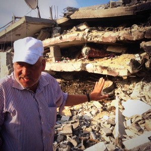 Abdul Rahman describes destruction in Beit Hanoun, photo by Max Blumenthal
