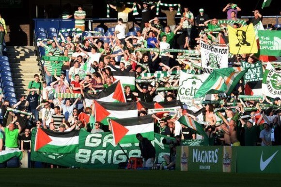 Celtic fans wave Palistinian flags during the game against KR Reykjavik at Murrayfield in July (photo:Scotland Now)