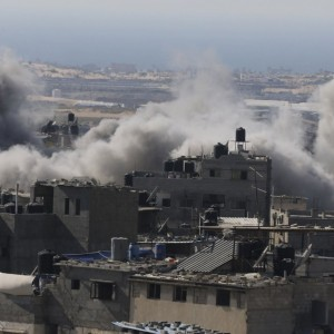 Smoke is seen following what police said was an Israeli air strike in Rafah in the southern Gaza Strip July 9, 2014. (PHOTO: Ibraheem Abu Mustafa/Reuters)