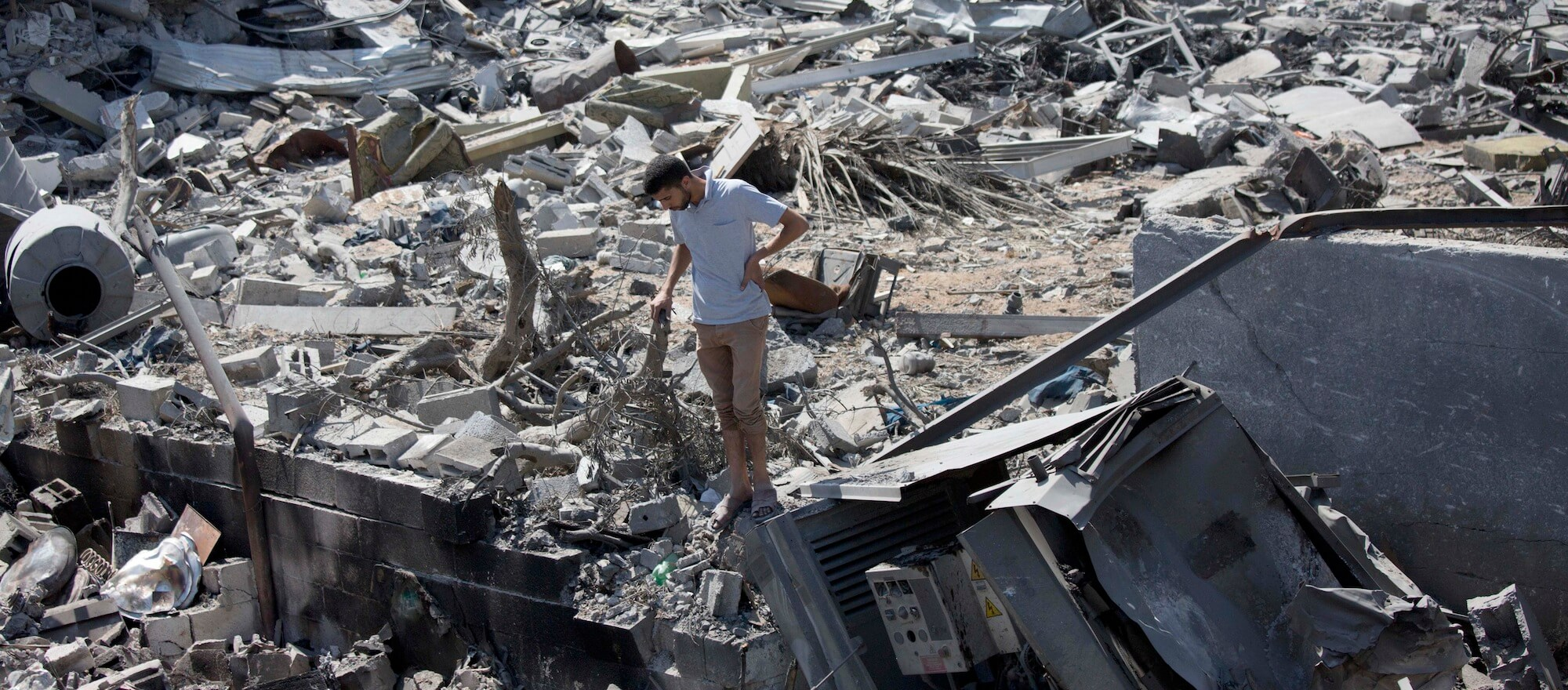 A Palestinian inspects a destroyed house in the heavily bombed Gaza City neighborhood of Shijaiyah, close to the Israeli border, Friday, Aug. 1, 2014. (AP Photo/Dusan Vranic)