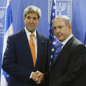 U.S. Secretary of State John Kerry shakes hands with Israeli Prime Minister Benjamin Netanyahu in Tel Aviv on July 23. (Photo: AFP)