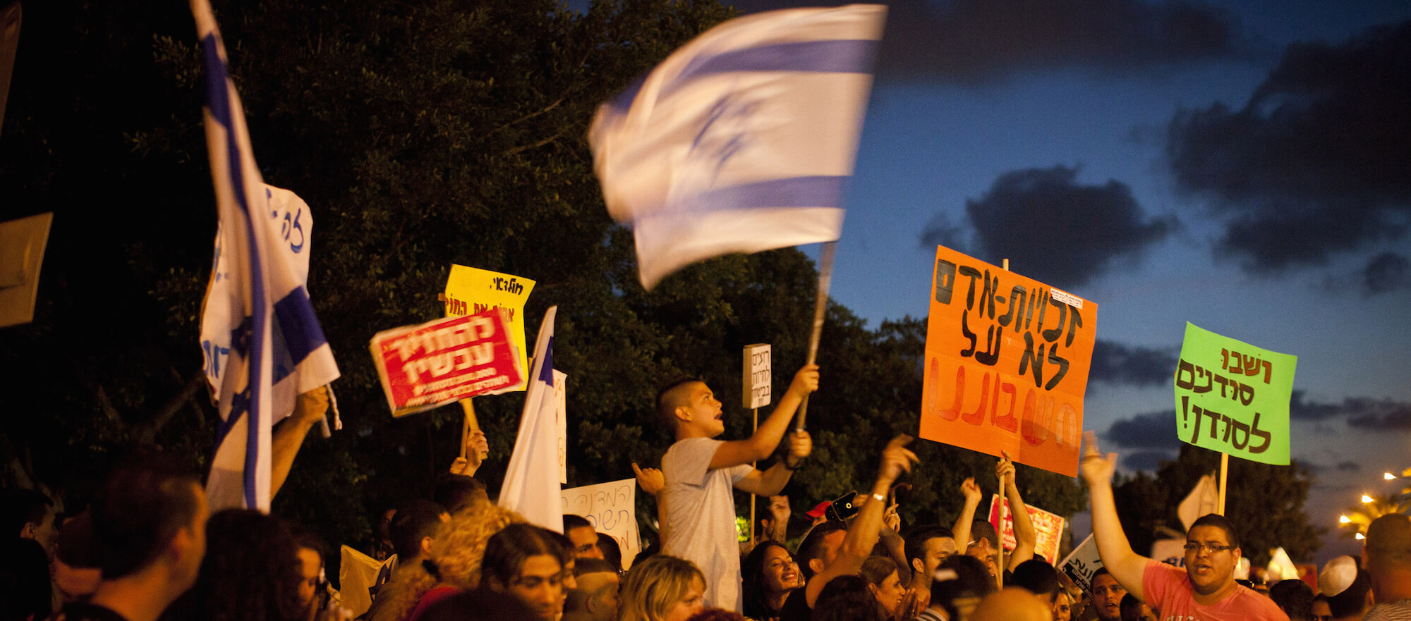 """Israelis chant """"Sudanese Back To Sudan"""" during a right-wing demonstration against African refugees in south Tel Aviv, 30 May 2012. (Photo: Oren Ziv / ActiveStills)"""